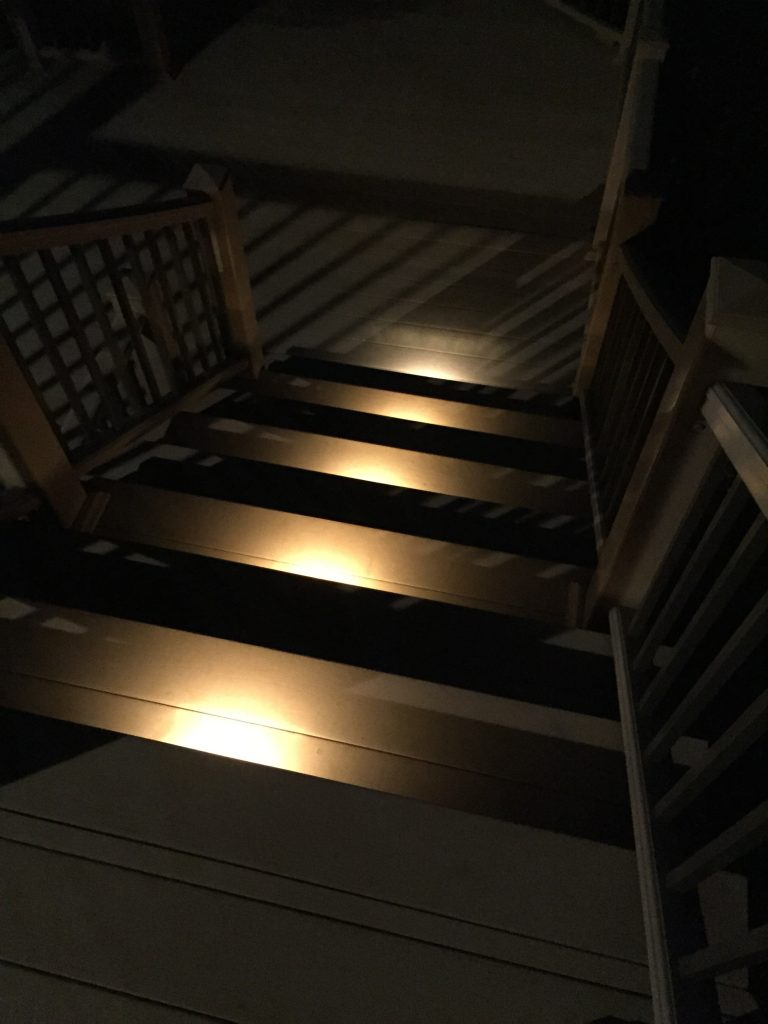 These are lights on a staircase that leads down from a deck.