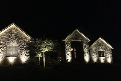 These are lights illuminating the front of a house.