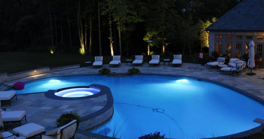 This is a pool with several underwater lights.