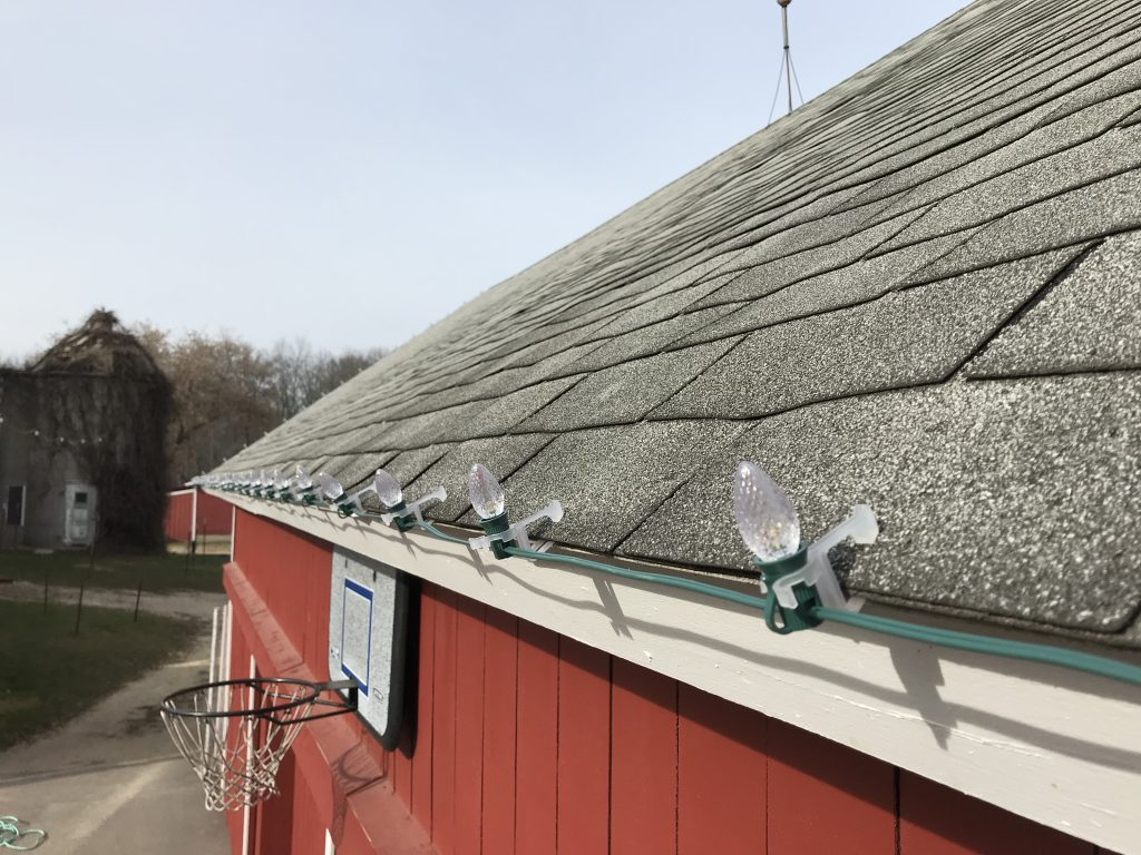 These are holiday lights clipped to the side of a roof.