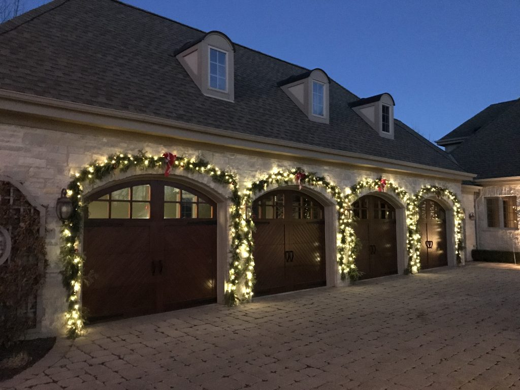 This is holiday lighting around the arches of garage doors.