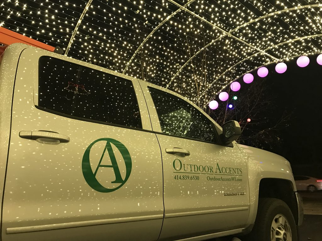 This is holiday lighting arching over the Outdoor Accents truck.